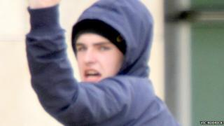 Outside court Begley threatened to smash the photographer's camera