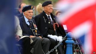 Dunkirk veterans (left) Michael Bentall, aged 94, and Garth Wright, aged 95, listen to a service