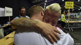 Couple embraces at Dublin referendum count