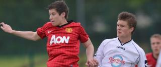 Paddy McNair in Milk Cup action for Manchester United against Revo Express in Ballymoney