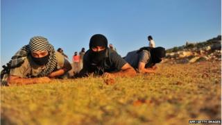 Members of Jihadist group Hamza Abdualmuttalib train near Aleppo on July 19, 2012