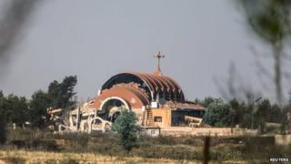 An Assyrian church is seen damaged in the village of Tel Nusri