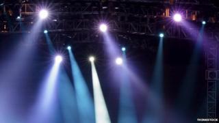 Spotlights in a theatre