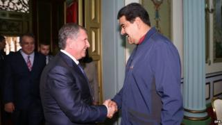 President Nicolas Maduro shakes hands with the CEO of Russian state-run oil company Rosneft Igor Sechin in Caracas on 27 May 2015