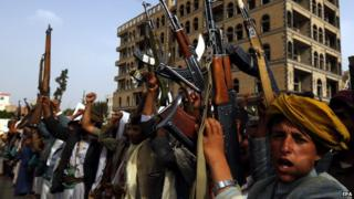 Armed Houthi supporters shout anti-Saudi slogans during a rally in Sanaa on 5 June 2015