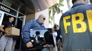 FBI agents carry boxes and computers from the headquarters of CONCACAF after it was raided on May 27, 2015 in Miami Beach, Florida