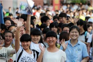 This picture taken on 8 June 2015 shows high school students walking out of a school after sitting the 2015 national college entrance examination, or the Gaokao, in Bozhou, east China's Anhui province