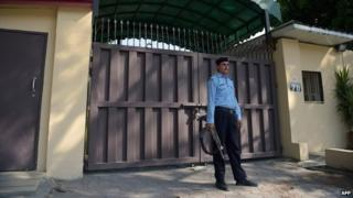 A Pakistani policeman stands guard outside the shuttered office of the international aid group Save the Children in Islamabad on June 15, 2015.