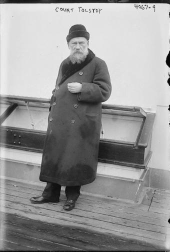 Leo Tolstoy stands on board the deck