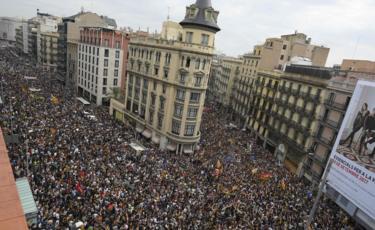 Protesters gather at the Placa de la Universitat square in Barcelona on 3 October