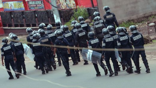 Riot police patrol for streets for Buea