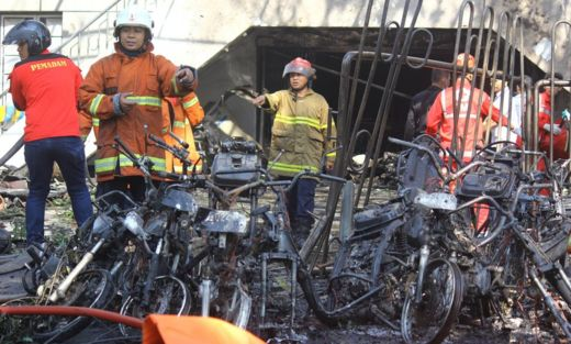 Firefighters are seen at the site of a blast at the Pentecost Church Central Surabaya (GPPS), in Surabaya, East Java, Indonesia, 13 May 2018