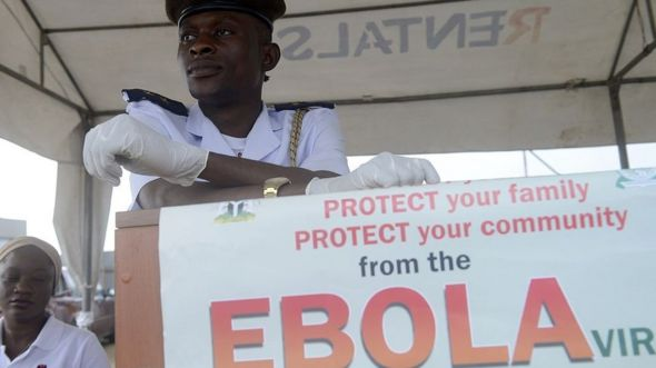A health official waits to screen for the Ebola virus Muslim faithfuls on pilgrimage to Mecca on September 19, 2014 at the Murtala Mohammed International Airport in Lagos.