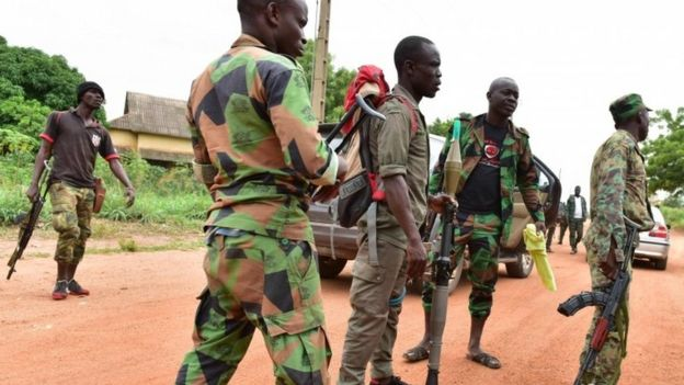 Mutinous soldiers stand inside a military camp in the Ivory Coast
