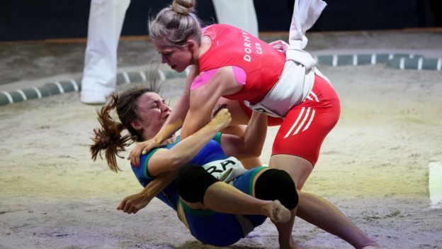 Germany's Julia Dorny, right, fights Brazil's Luciana Montogomery Higuchi during the Sumo Open Weight Women's Competition of The World Games