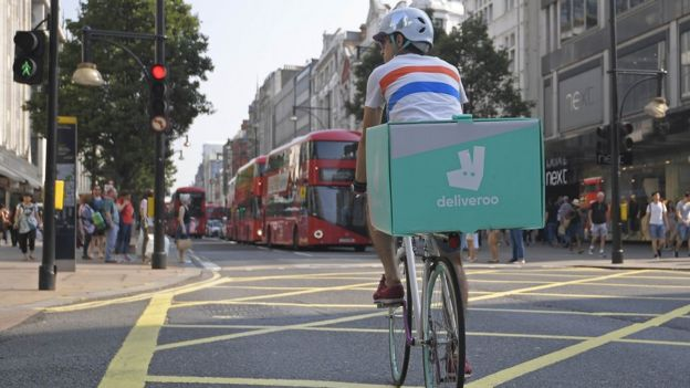 A cyclist delivering food for Deliveroo