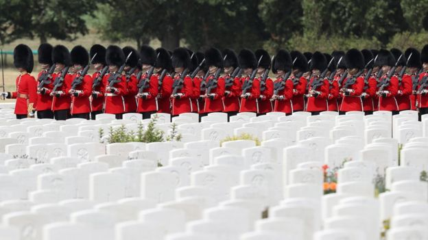 Members of the Queen's Guard march at the Tyne Cot cemetery