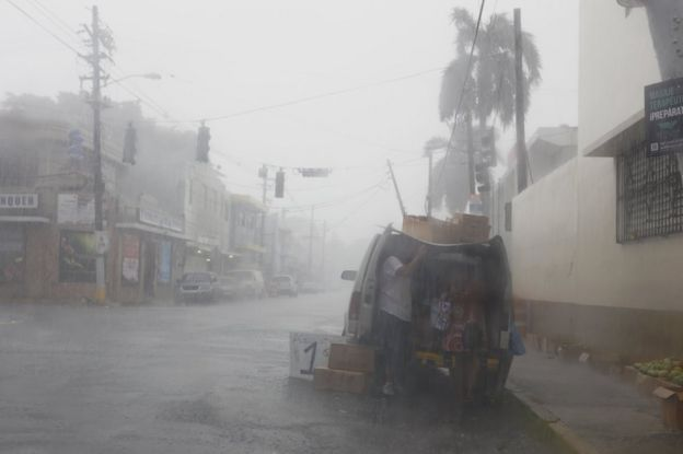 Citizens prepare for the imminent passage through the island of Hurricane Irma in San Juan, Puerto Rico, 6 September