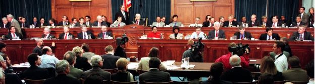 Members of the House Judiciary Committee discuss articles of impeachment against US President Bill Clinton 11 December 1998