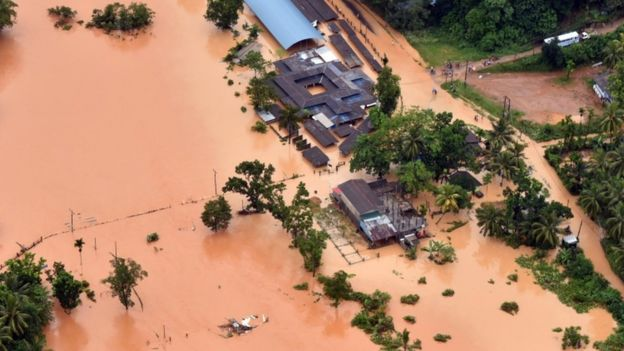 An aerial shot shows flood water surrounding houses in Sri Lanka