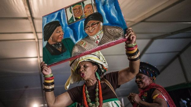 African National Congress Women League members, holding a painting, dance during the celebration of the 80th birthday of Africa National Congress stalwart Winnie Madikizela Mandela on September 26, 2016 in Soweto