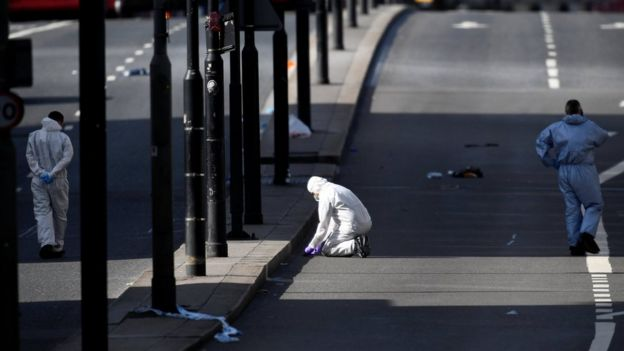 Police forensics investigators working on London Bridge on Sunday morning