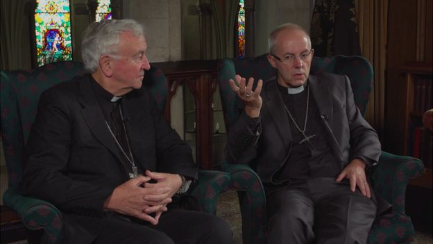 Vincent Nichols and Justin Welby, seated