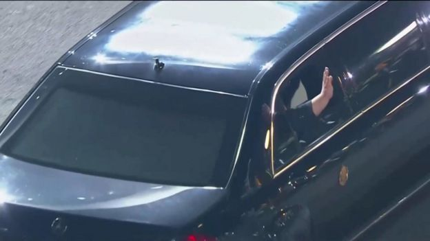 Mr Kim waves as he returns to North Korea