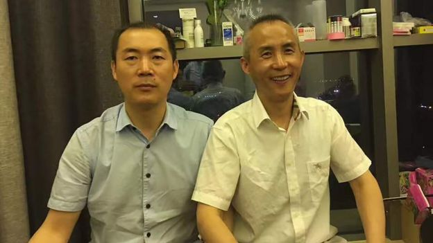 维权律师李和平(右)