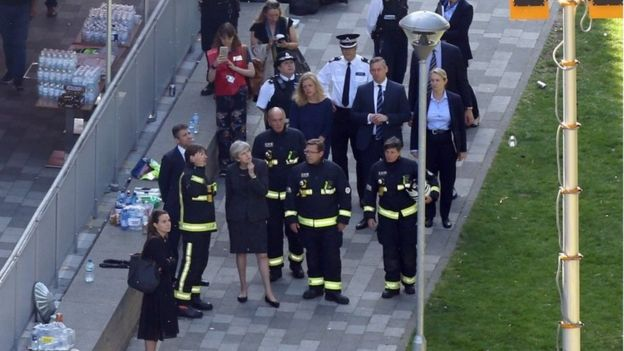 Theresa May with firefighters