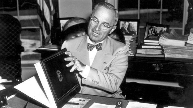 The 33rd President of the United States Harry S Truman (1884 - 1972) examining the United Nations Charter in Washington