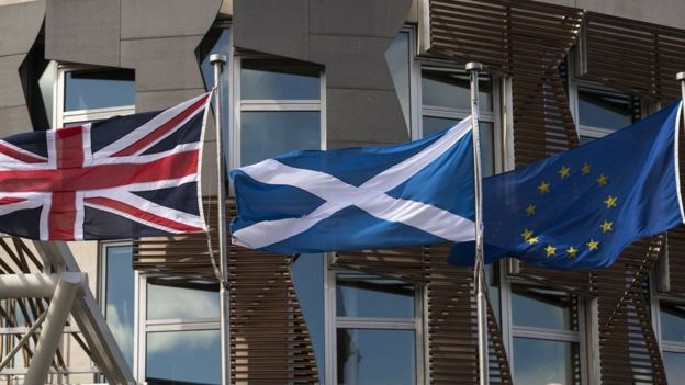Flags of UK, Scotland and the EU in front of the Scottish Parliament in Edinburgh on June 27, 2016