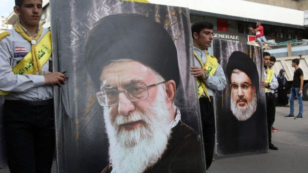 Hezbollah supporters carrying posters Iran's Supreme Leader Ayatollah Ali Khamenei and Hezbollah leader Hassan Nasrallah in the southern Lebanese city of Nabatieh (8 November 2017)