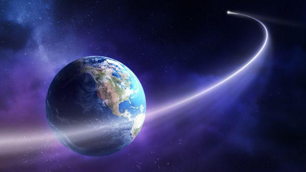 Ilustración de un cometa pasando cerca de la Tierra