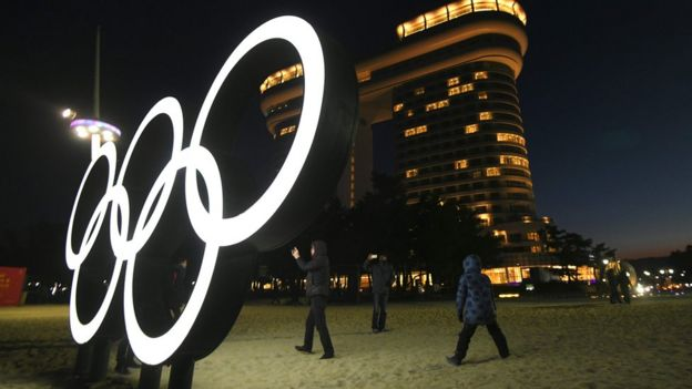 The Olympic rings light up at night on Gyeongpo beach, Gangneung