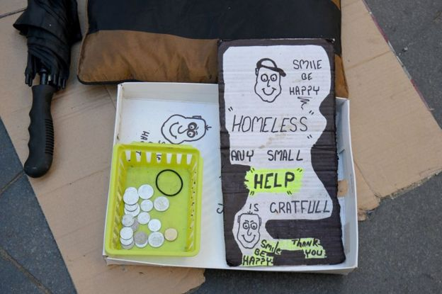 A homeless person's sign, asking for help