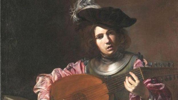 Un muchacho tocando el laúd, en una pintura de Valentin de Boulogne