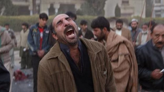 A survivor is overcome with emotion at the site of a bomb blast attack on former Prime Minister Benazir Bhutto on December 27, 2007 in Rawalpindi, Pakistan.