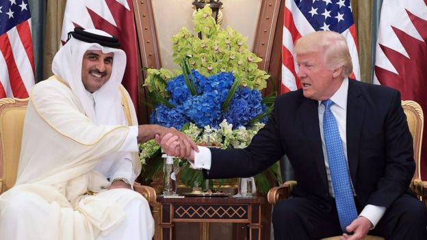 This file photo taken on May 21, 2017 shows US President Donald Trump (R) shaking hands with Qatar