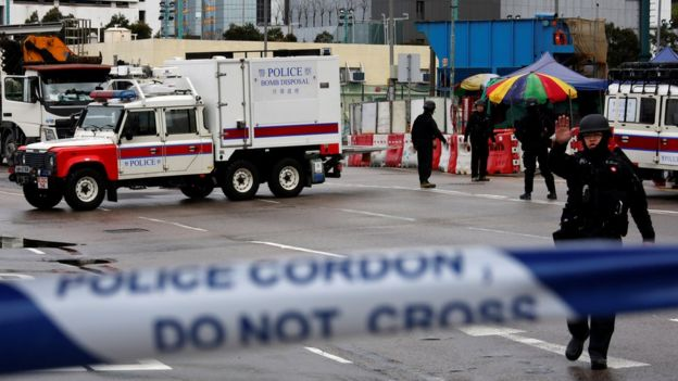 Members of the police bomb squad cordon off an area where a World War Two bomb was found at a construction site in Hong Kong