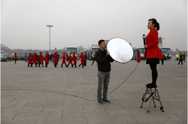 "A Chinese TV journalist makes her report on Tiananmen Square during the opening of the 1st Session of the 13th Chinese People""s Political Consultative Conference (CPPCC) National Committee at the Great Hall of the People (GHOP) in Beijing, China, 03 March 2018. The CPPCC is the top advisory body of the Chinese political system and runs alongside the annual plenary meetings of the 13th National People""s Congress (NPC), together known as ""Lianghui"" or ""Two Meetings"". EPA/HOW HWEE YOUNG"