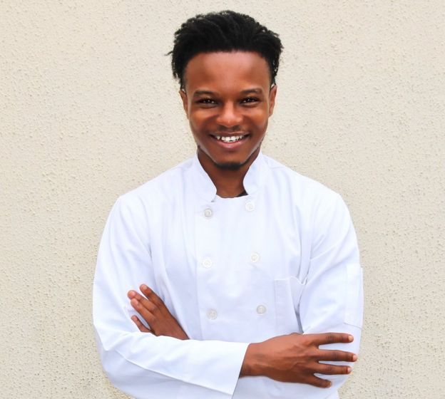 Michael Elegbde, pictured in his white chef's coat