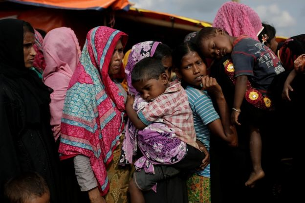 Rohingya refugees line up for a food supply distribution at the Kutupalong refugee camp near Cox's Bazar, Bangladesh 12 December 2017.