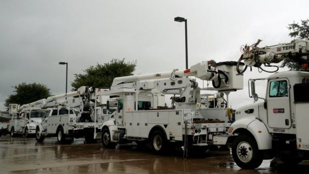 Power company trucks are staged in advance of Hurricane Harvey in Victoria, Texas (25 August 2017)
