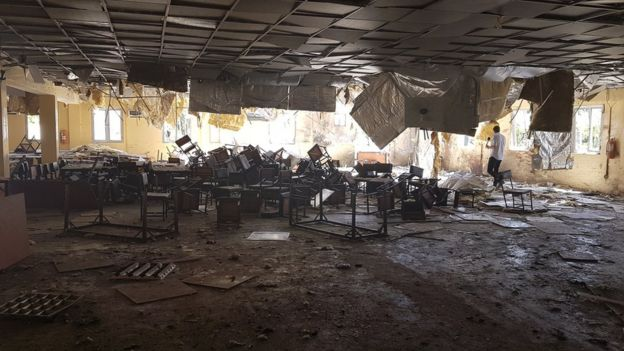 Overturned tables and chairs inside army base