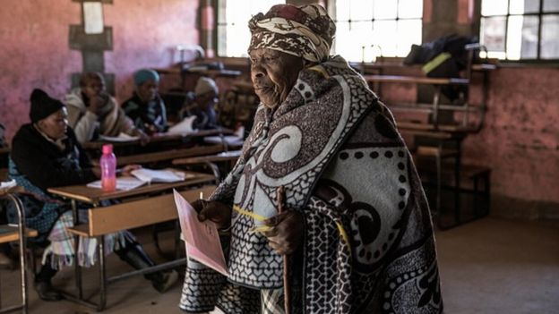 A Mosotho woman walks to mark her ballot at the boot during Lesotho general elections at a polling station on June 3, 2017 in the remote village of Nyakosoba
