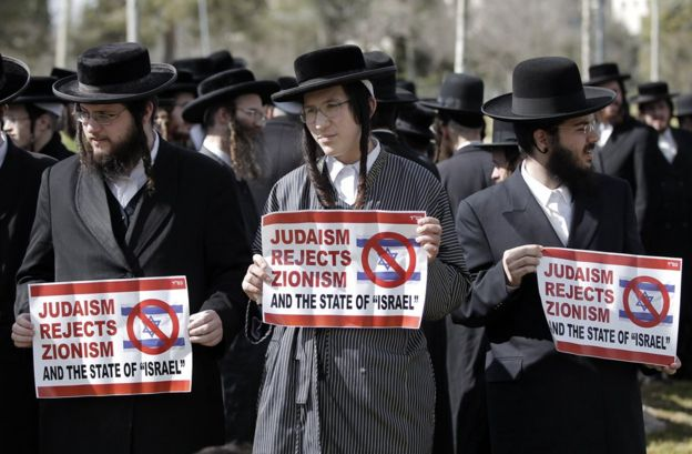 Ultra-Orthodox Jewish protestors, some of them belonging to Neturei Karta, a small