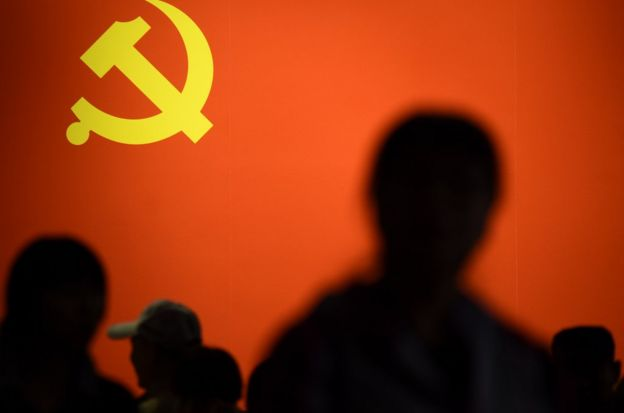 This picture taken on October 10, 2017 shows a party flag of the Chinese Communist Party displayed at an exhibition showcasing China's progress in the past five years at the Beijing Exhibition Center. China's police and censorship organs have kicked into high gear to ensure that the party's week-long, twice-a-decade congress goes smoothly when it begins on October 18. / AFP PHOTO / WANG ZHAO / TO GO WITH CHINA-POLITICS-SECURITY, FOCUS BY BECKY DAVIS (Photo credit should read WANG ZHAO/AFP/Getty Images)