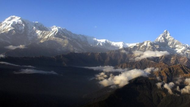 The Himalayan Mountains pictured from Mount Machhapuchre (R) and Mount Annapurna from Pokhara, west of Kathamndu