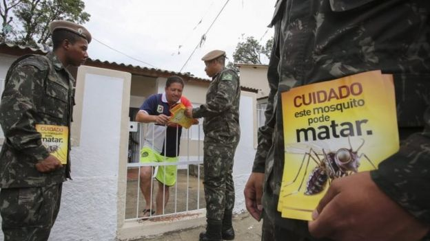 Brazilian soldiers give a resident in Sao Paulo leaflets that read: